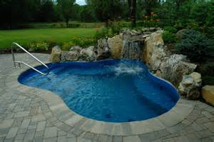 Backyard Pool Design Island Swimming Pool Design By The Deck And Patio Company