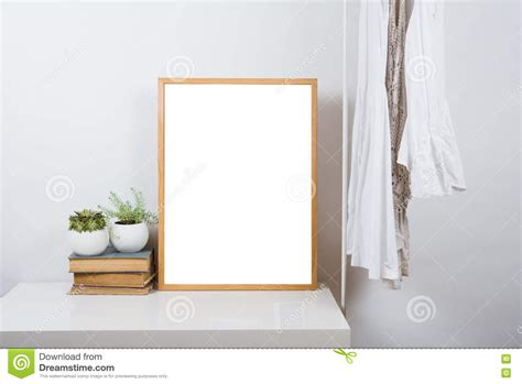Empty wooden picture frame on the table art print mock up stock photo image of blank room