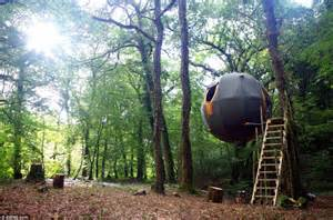 suspended tree tree tents suspended from wires in cornish forest are