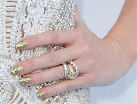 miley cyrus still wearing engagement ring report ny
