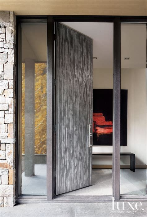 Metal Front Doors Architect Eric And Interior Designer Catherine Frank Took The Simplicity Of This Home