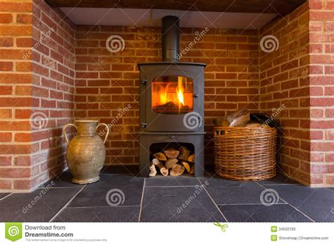 wood burning stove in brick fireplace stock image image