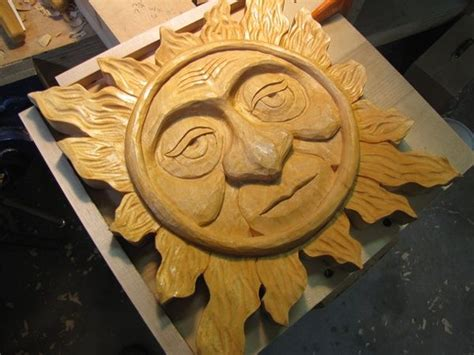 carved  sun  carving  larger sun