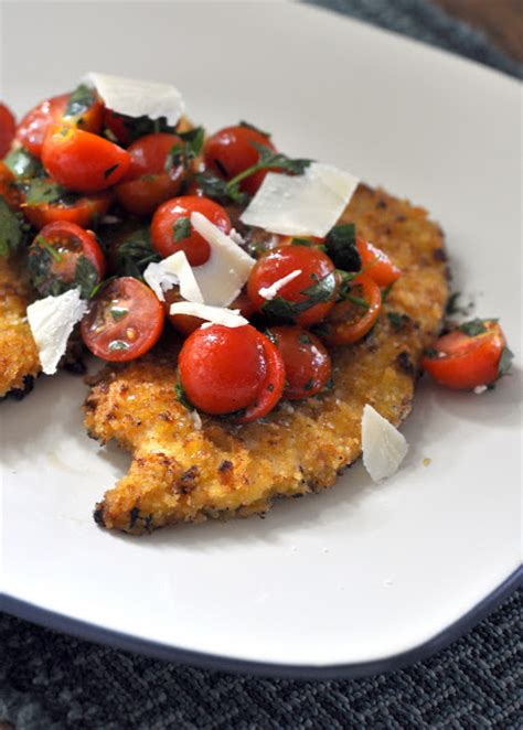 spicy veal parmesan spicy chicken milanese with tomato salad and parmesan