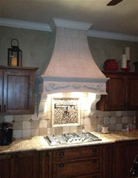 best range hoods centro island hood with drywall finish custom curved drywall hood with corbels painted to match