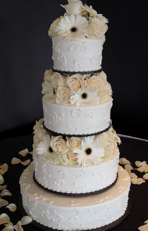 White buttercream iced, 4 tier round wedding cake