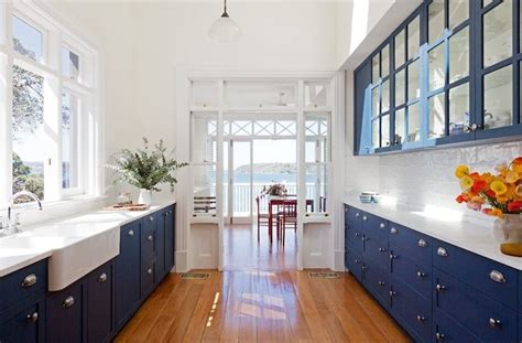 white and blue kitchen cabinets blue galley kitchen cottage kitchen arent pyke