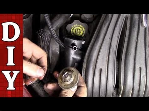 remove  replace  thermostat chrysler pt
