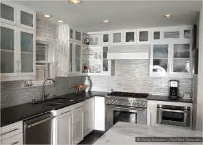 Kitchen Backsplash For White Cabinets by Black Countertop Brown Backsplash White Cabinet Black