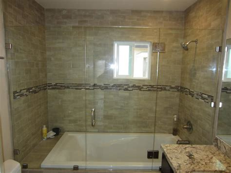 Bath And Shower Doors White Bath Tub Combined With Large Glass Door Plus Silver Steel Handler On The Light Brown Tile