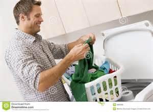 man doing laundry royalty free stock image image 6882086