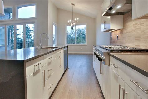 kitchen home design transitional medium tone wood floor kitchen pleasing contemporary open concept with waterfall