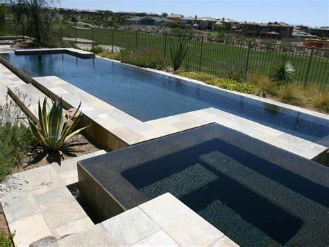 modern pool modern pools with black river rock border google search