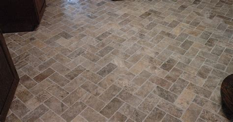 Custom Bathroom Remodeling: Natural Stone Herringbone Tile
