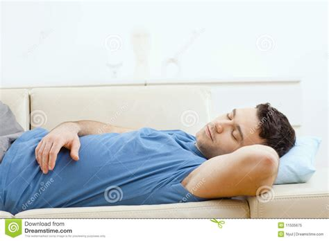 sleep on couch man sleeping on couch stock image image of beige