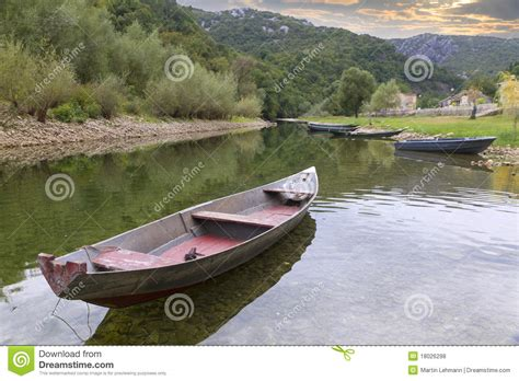 peace valley boat rental old boats on a calm river royalty free stock photos
