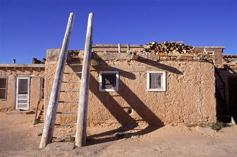 what is an adobe house adobe houses and a ladder casting photograph by ira block