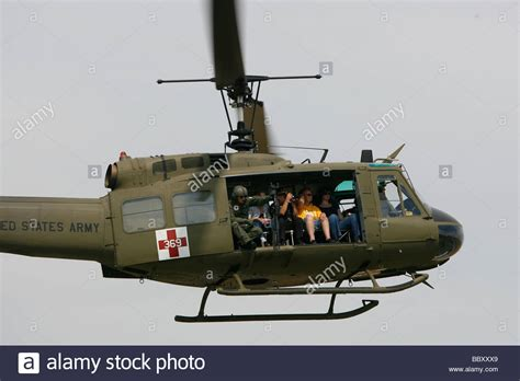 a era uh 1 huey helicopter flies during a veterans stock photo royalty free