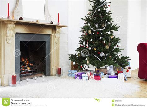 Living Room Presents Fireplace And Tree With Presents Stock Photo