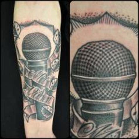 microphone tattoo on neck big tattoo planet microphone big tattoo planet