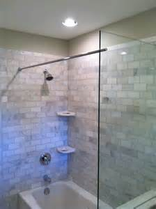 Shower Rail For Corner Bath this tub shower benefits from a glass splash panel as well