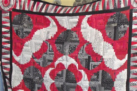 curved log cabin quilt with us