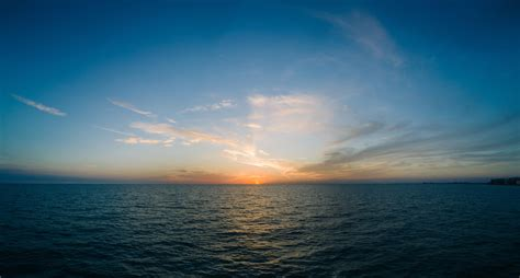 wallpaper sea horizon sunset clouds sky hd