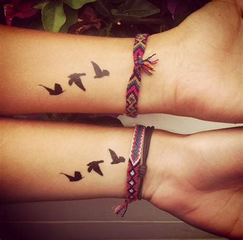 matching bird tattoos birds flying away