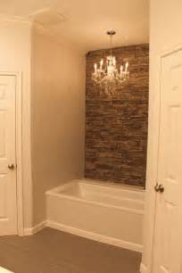 my tub with faux wall accent wall and chandelier