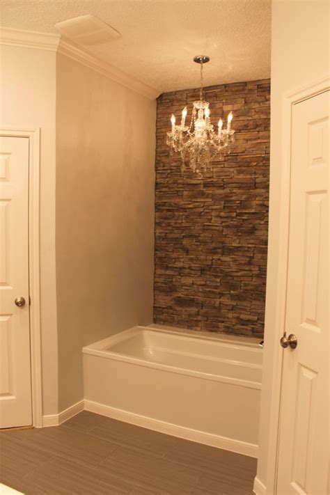 tile accent wall in bathroom my tub with faux stone wall accent wall and chandelier