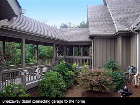 detached garage with breezeway covered deck and breezeway leading to the detached garage