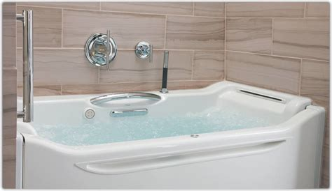 soaking in bathtub kohler k 1914 grb 0 elevance bubblemassage rising wall