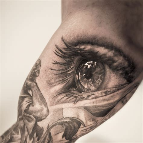 tattoo eyeball realistic grey ink eye on biceps