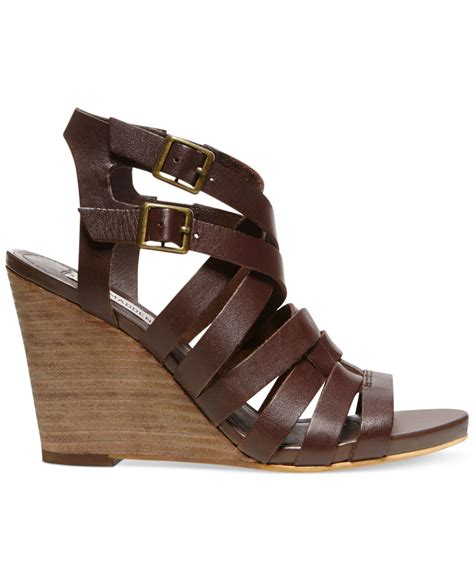 brown steve madden sandals lyst steve madden venis caged wedge sandals in brown