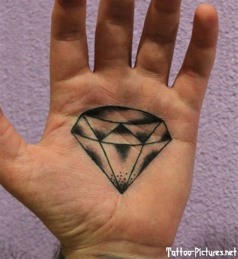 tattoo of eye in palm of hand black ink illuminati eye tattoo on hand palm