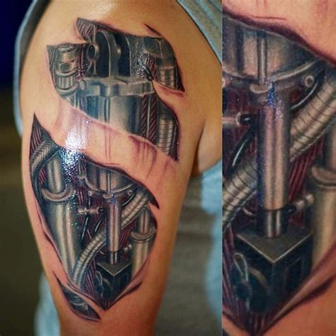 biomechanical name tattoo glowing biomechanical tattoo on shoulder tattooshunt com