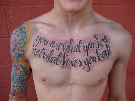 love tattoo for men quote grey ink on chest for tattooshunt