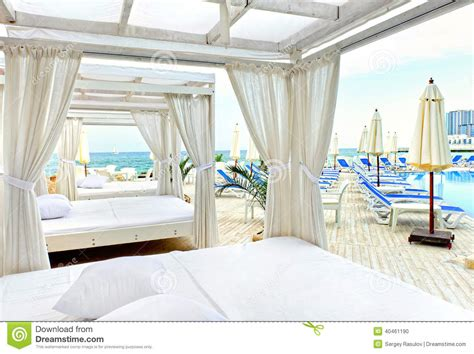 canopy bed in stock photo image of resort pool