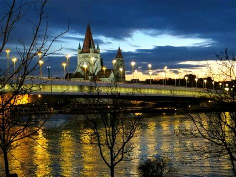 A Bridge Over Danube River Captured With Lights And Vienna Lights