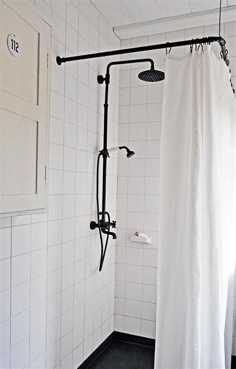 shower curtain for corner bath black shower curtain rod from metal fittings the ceiling is lined with wood sourced from