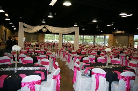 This wedding reception used black table cloths, black and