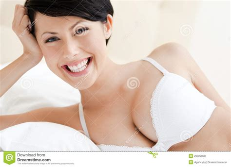 wearing a bra to bed woman in white bra is lying in the double bed stock photo image 26322000