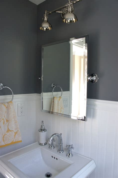 bathroom light fixtures above mirror home with baxter bathroom art and other updates
