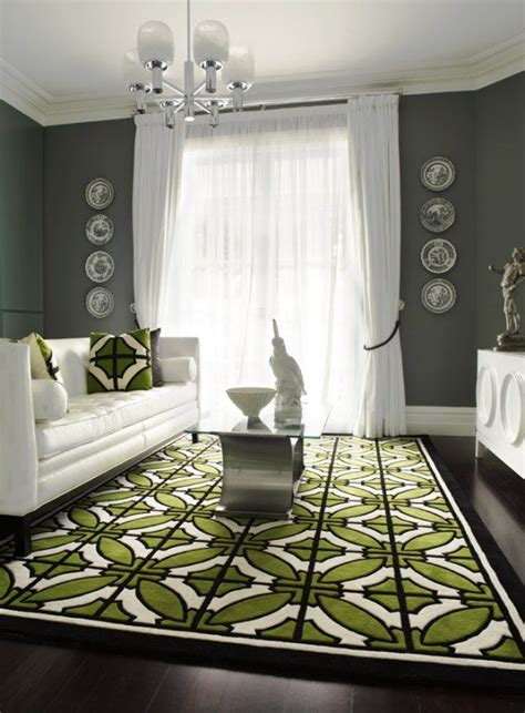 white furniture gray walls geometric green white rug