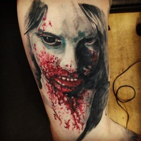 zombie tattoo on leg by graynd tattooimages biz bloody colored upper arm tattoo of zombie woman face