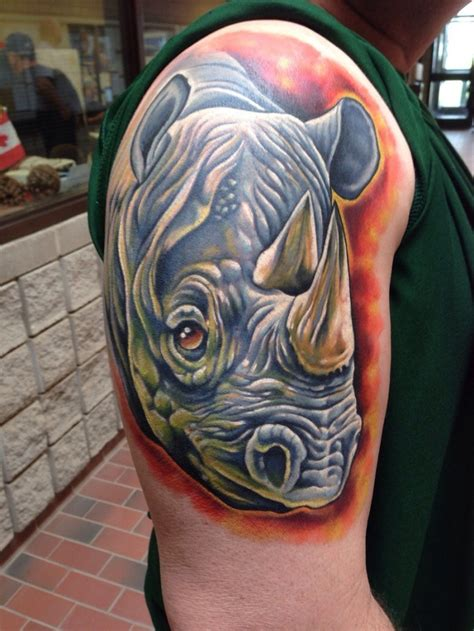 rhino tattoo 9 rhino design ideas and sles
