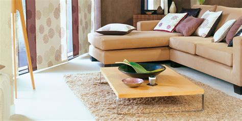 where to place a rug in your living room how to place your rug correctly in the bedroom dining room and living room