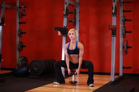 dumbbell swing bodybuilding plie dumbbell squat exercise guide and video