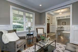craftsman living room with high ceiling amp wainscoting in