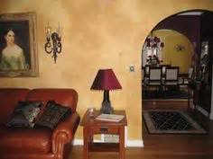 cost of plastering room i hated the mustard color on my walls using behr faux glaze and a sea sponge roller i went